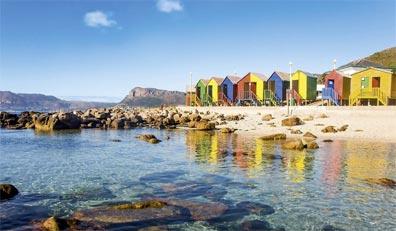 »Rundreise durch Südafrika: Strandkabinen in Muizenberg«